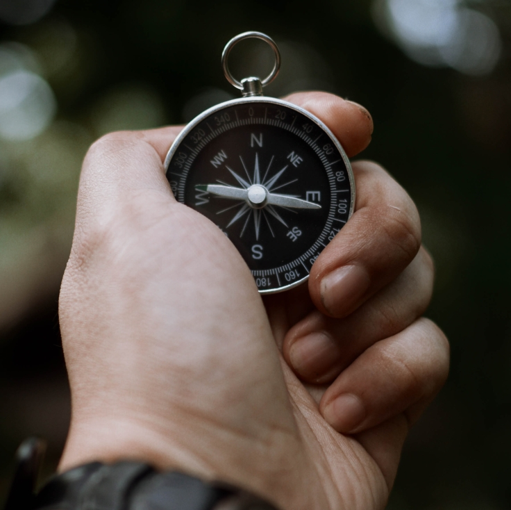 person-holding-a-compass-3537823